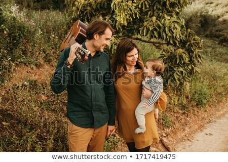 Szülők baba természet mosoly arc fű Stock fotó © Paha_L