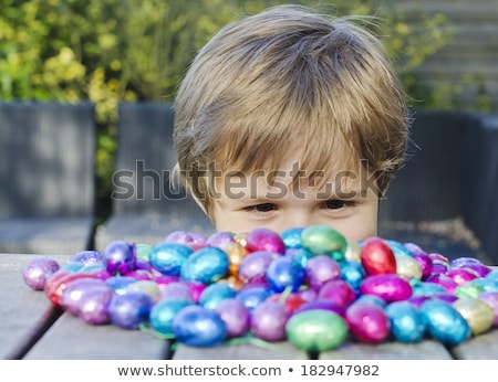Boy with chocolate easter eggs Stock photo © lovleah