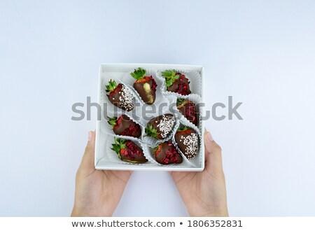 Female eating fresh strawberries in chocolate Stock photo © lovleah