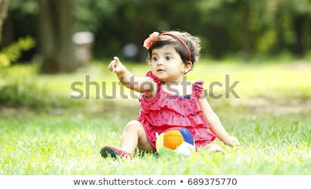 baby girl sitting on meadow Stock photo © phbcz
