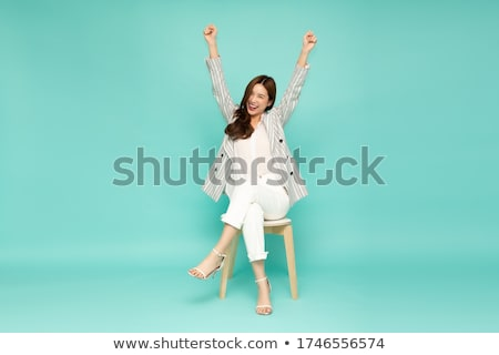 Woman sitting in arm chair Stock photo © nyul