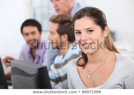 Brunette student sat next to class mates Stock photo © photography33