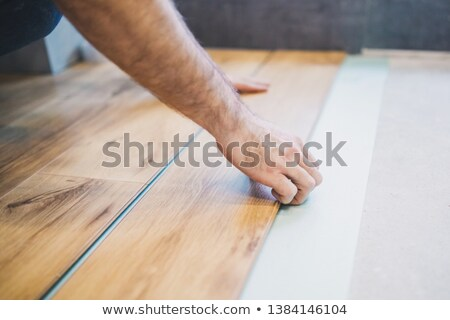 Montage of a worker laying floor Stock photo © photography33