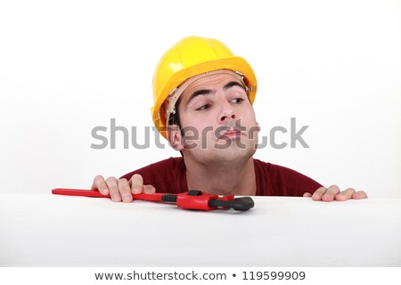 Curious tradesman peering over a ledge Stock photo © photography33