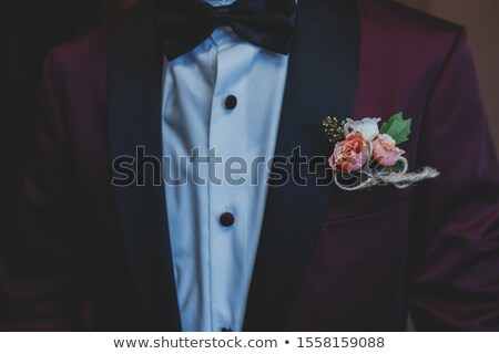 wedding buttonhole with rose on mans suite Stock photo © artjazz
