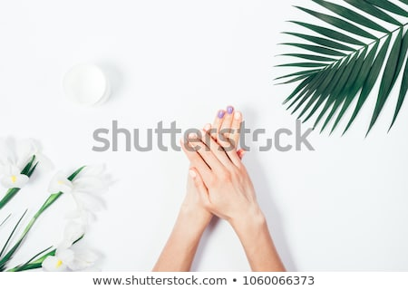 Putting Hand Cream On Her Hands Stock photo © stuartmiles