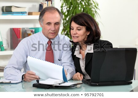 Business colleagues looking at a calender Stock photo © photography33