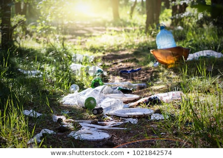 Stock photo: Pile of garbage on green grass in the nature environment problem