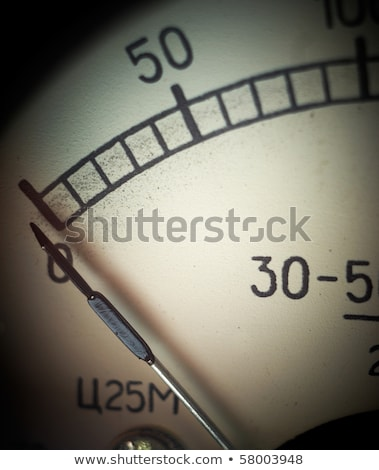 Vintage analog voltmeter dial closeup. Shallow DOF. Stock photo © pashabo