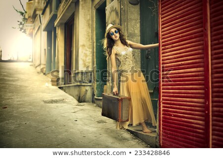 Woman in sunglasses with a suitcase Stock photo © photography33