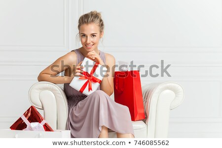 Beautiful red-haired girl with present box. Stock photo © Massonforstock