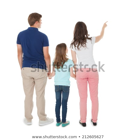Rear view of young woman in casuals, pointing Stock photo © stockyimages