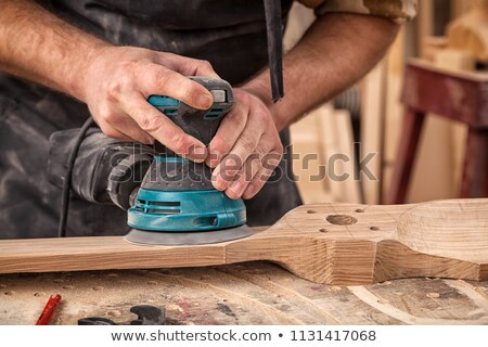 Man holding electric sander Stock photo © photography33