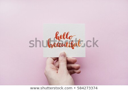 Stock photo: Female's hand holding colorful word 'Holiday'