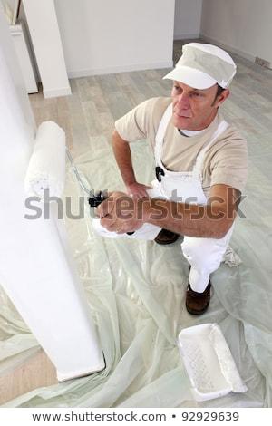 Tradesman painting a column Stock photo © photography33