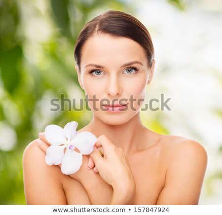 Stock photo: Healthy clean girl face - healthcare and beauty, flower orchid