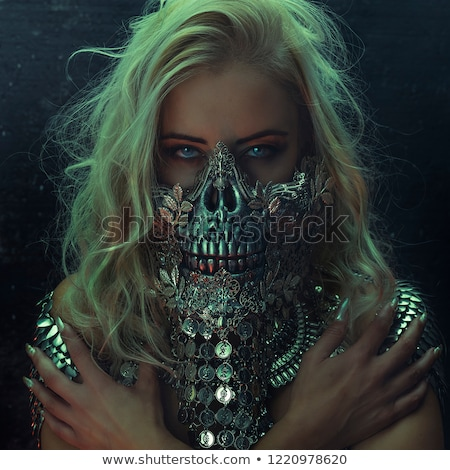 beautiful blonde woman in carnival costume of devil stock photo © pilgrimego