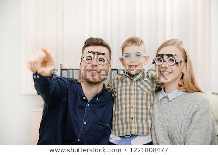 Szőke gyerekek lány optometrikus szemüveg mosolyog Stock fotó © lunamarina