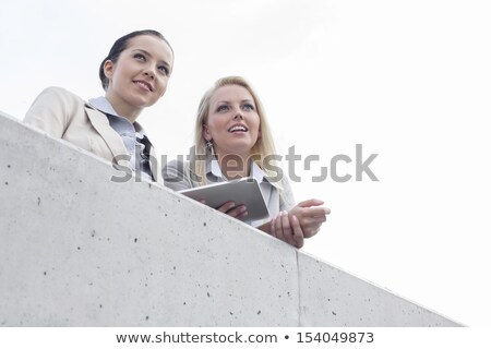 Businesswoman looking at the sky Stock photo © photography33