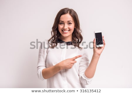 Stock photo: Smiling Young Woman Holding Smart Cell Phone on White