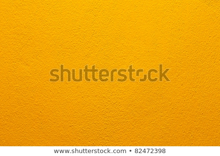 orange structural painted wallpaper on the wall Stock photo © tarczas