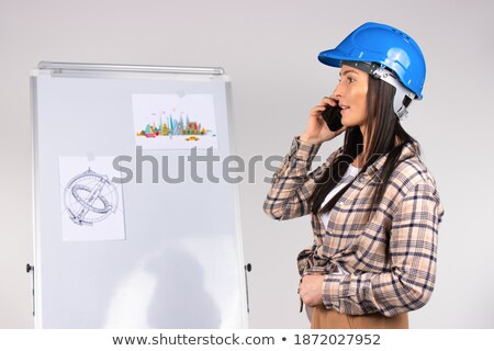 Architect on the phone against a white background stock photo © wavebreak_media