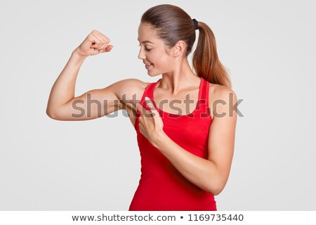 vrouw · tonen · biceps · foto · jonge - stockfoto © wavebreak_media