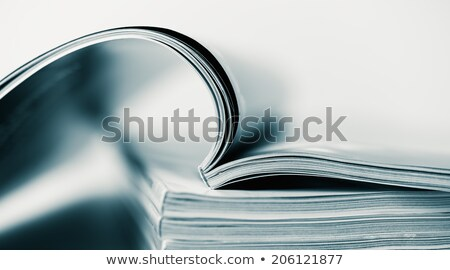 stack of open magazines stock photo © zhekos