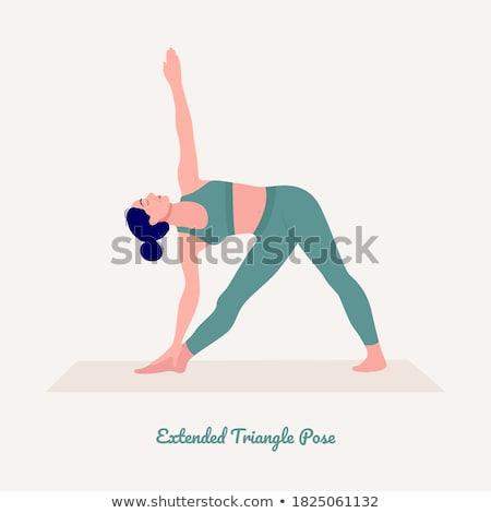 Smiling girl in extended triangle yoga pose stock photo © wavebreak_media