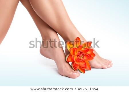 Virágok láb narancs láb hatalmas szobor Stock fotó © THP