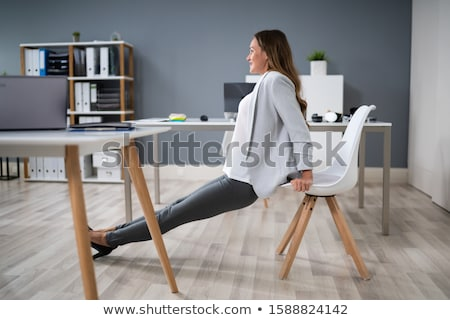 Side view of young  woman stretching on hardwood floor Stock photo © wavebreak_media