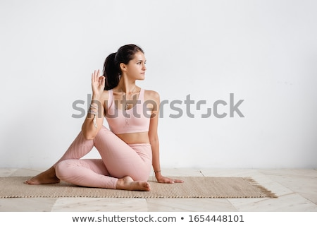 young attractive woman doing pilates stock photo © juniart