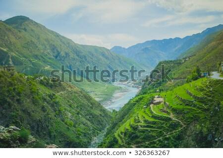 Serpentine road in Himalayas mountains Stock photo © dmitry_rukhlenko