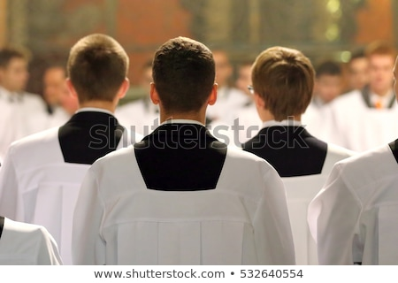 catholic priest on altar praying during mass stock photo © diego_cervo