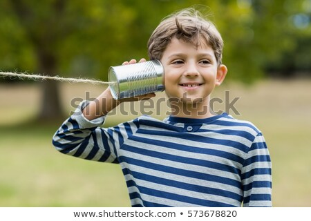child with tin can phone looking to camera Stock photo © gewoldi