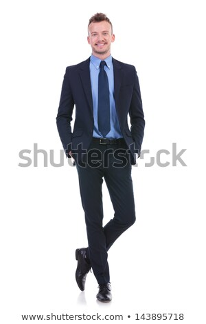 Сток-фото: Young Business Man Smiles With Both Hands In Pockets