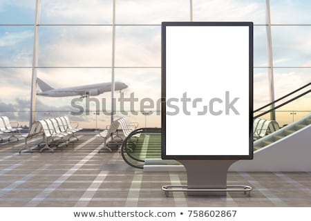 Foto stock: Blank Billboard With Airplane On The Sky