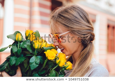 Stock fotó: Laughing Girl With Rose