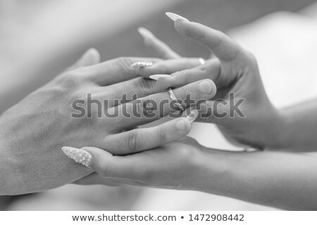 bride putting a wedding ring on groom s finger close up stock photo © vichie81