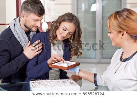 couple choosing a ring at the jeweller stock photo © kzenon