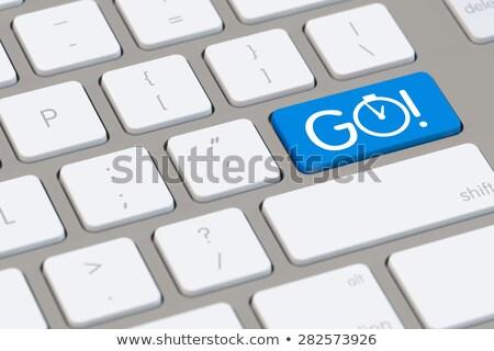 motivation   button of computer keyboard stock photo © tashatuvango