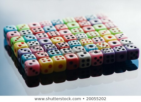Plastic colorful dices over glass surface Stock photo © Nejron