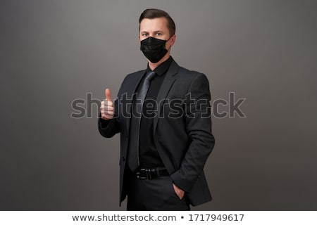businessman   costume mask stock photo © dgilder