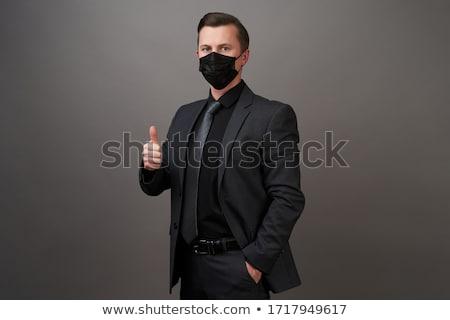 üzletember jelmez maszk izolált stúdiófelvétel tart Stock fotó © dgilder