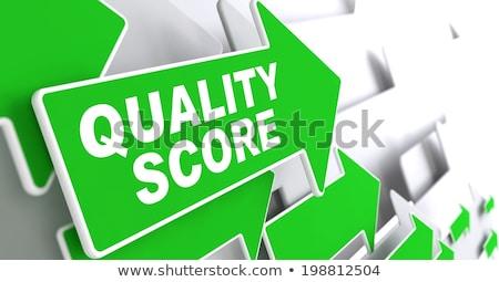 Quality Score on Green Direction Arrow Sign. Stock photo © tashatuvango