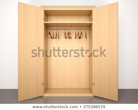 Wooden hanger hanging in an empty closet stock photo © punsayaporn
