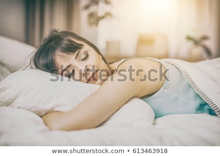 Stock photo: Beautiful young woman sleeping peacefully in bed