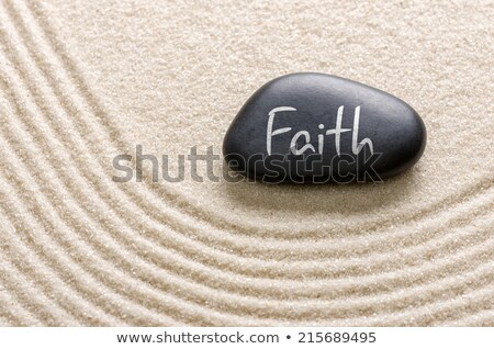 Black stone with the inscription Faith Stock photo © Zerbor