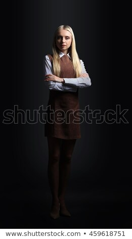 Stylish young business woman wearing dark suit smiling and confident stock photo © darrinhenry