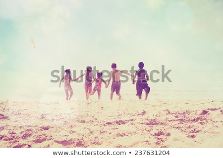 The boy is running in the water of lake. stock photo © EFischen